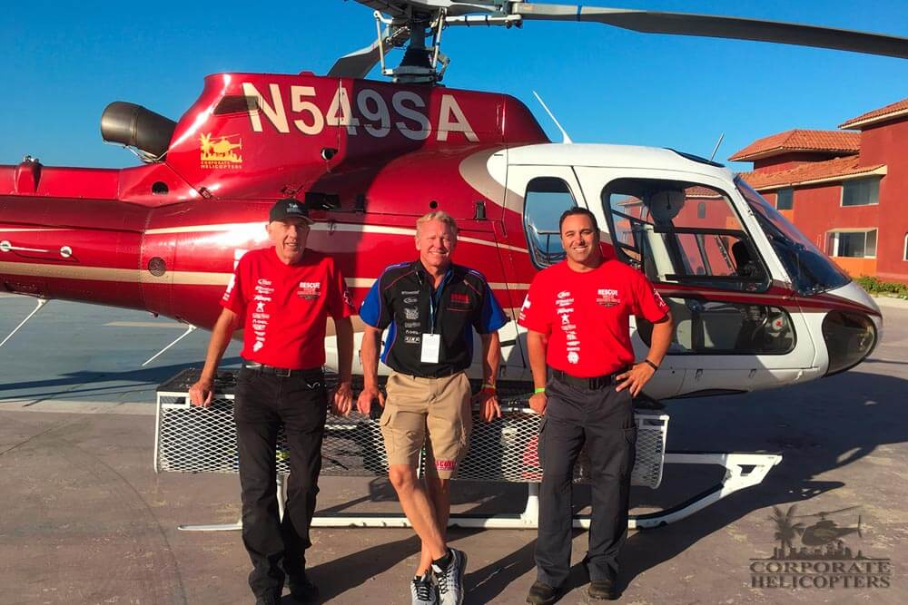 Corporate Helicopters at the SCORE Rosarito Beach Desert Challenge. Pictured: Ivor Shier (medevac pilot), Roger Norman (race organizer), Tom Perioni (flight Medic). Photo by Russ Stolzoff (chief flight paramedic).