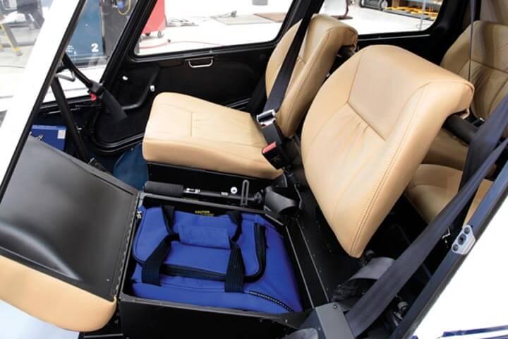 R44 storage under seats