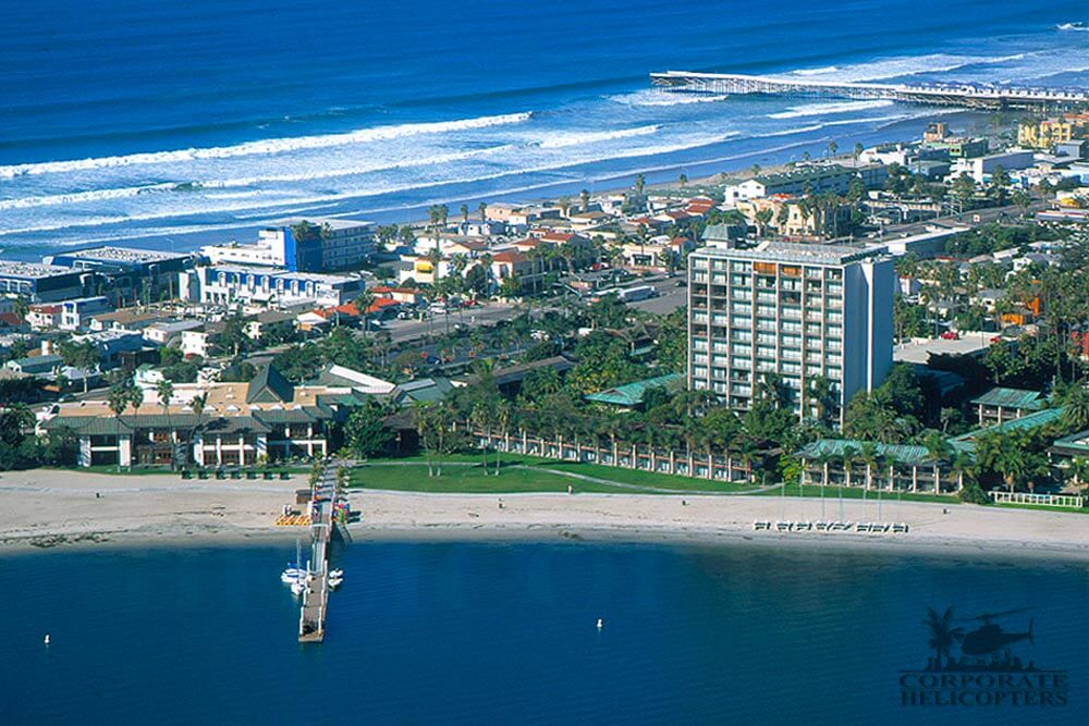 Helicopter tour from Corporate Helicopters of San Diego. Helicopter flying over the Catamaran on Mission Bay.
