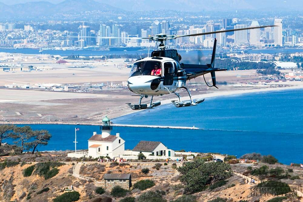 Helicopter tour from Corporate Helicopters of San Diego. Flying over the Old Point Loma Lighthouse on San Diego Bay.