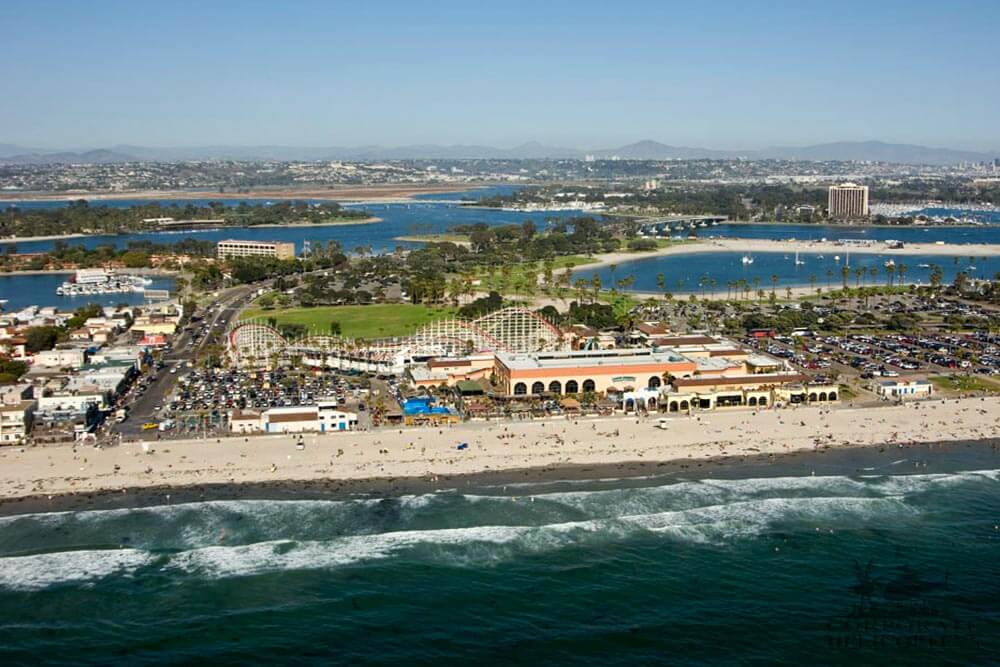 Helicopter tour from Corporate Helicopters of San Diego. Helicopter flying over Belmont Park on Mission Bay.